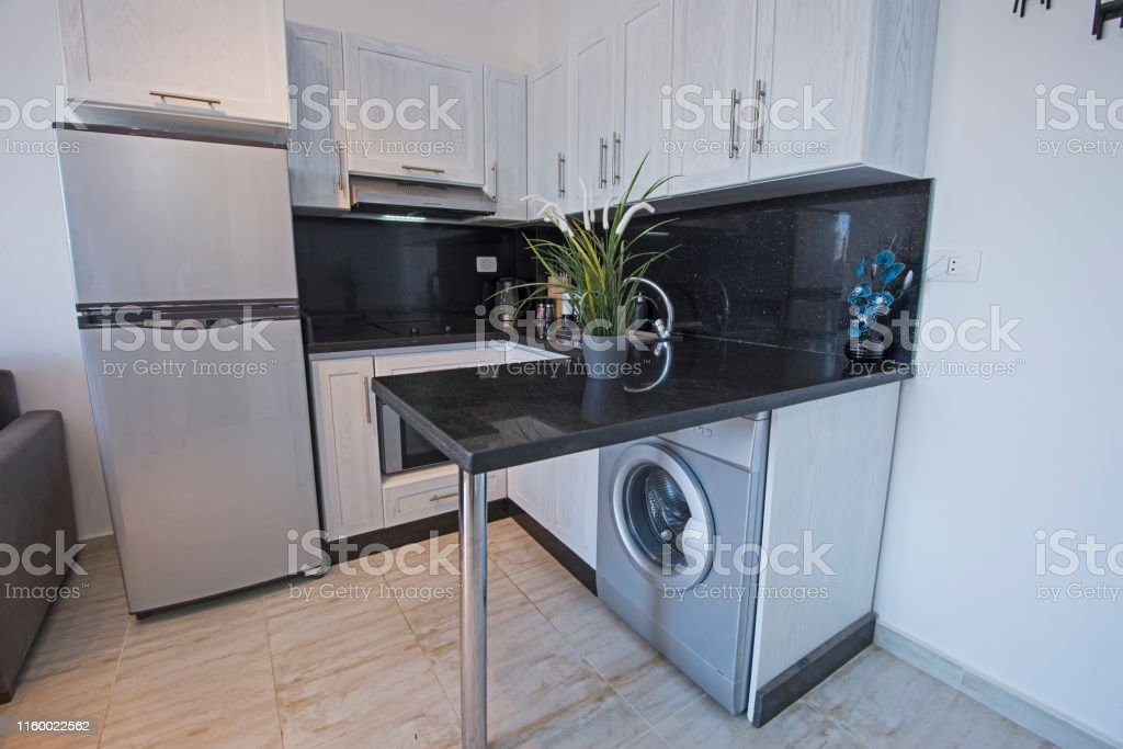 Modern Kitchen Design In A Luxury Apartment Stock Photo Download Image Now Istock