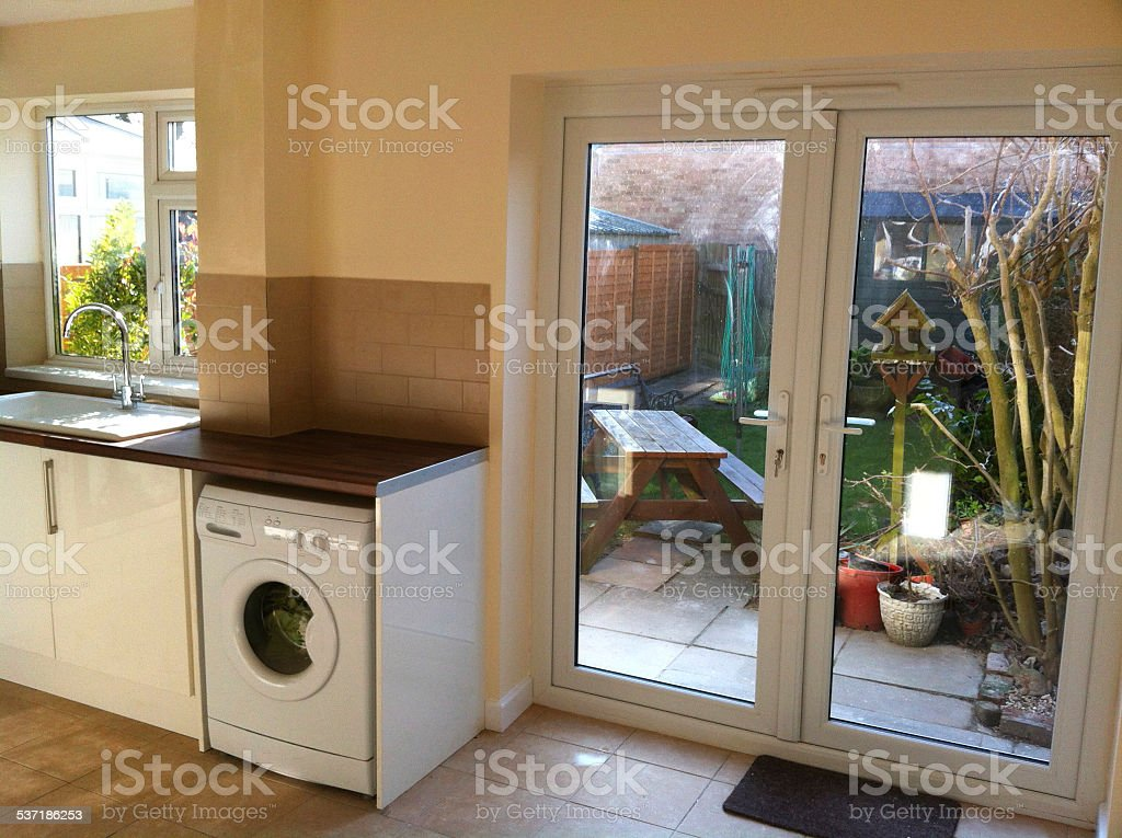 Modern Kitchen Diner, White Cupboards, Washing Machine, Patio Doors / Back  Garden