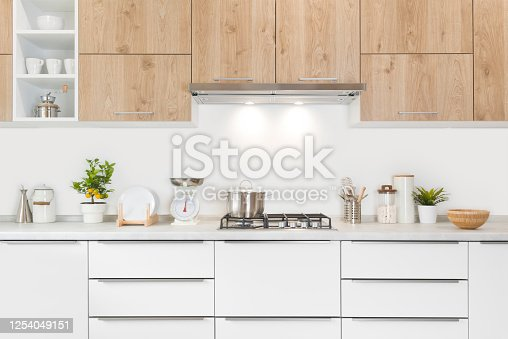 istock Modern kitchen furniture with gas stove, pot and various utensils 1254049151