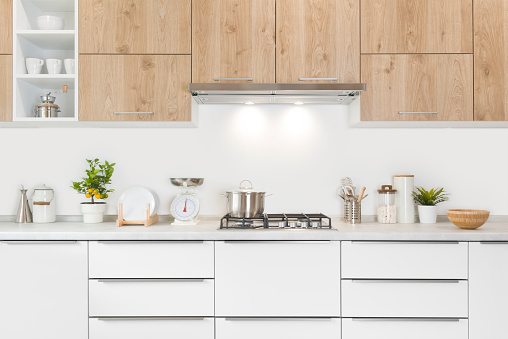 Modern kitchen furniture with gas stove, pot and various utensils