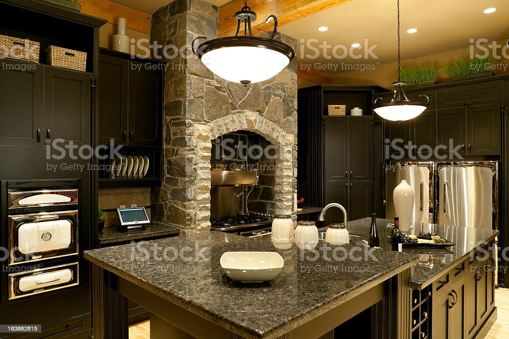 Modern kitchen home interior with marble counter tops royalty-free stock photo