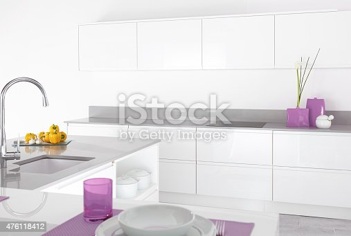 image of a modern kitchen interior with purple accessories