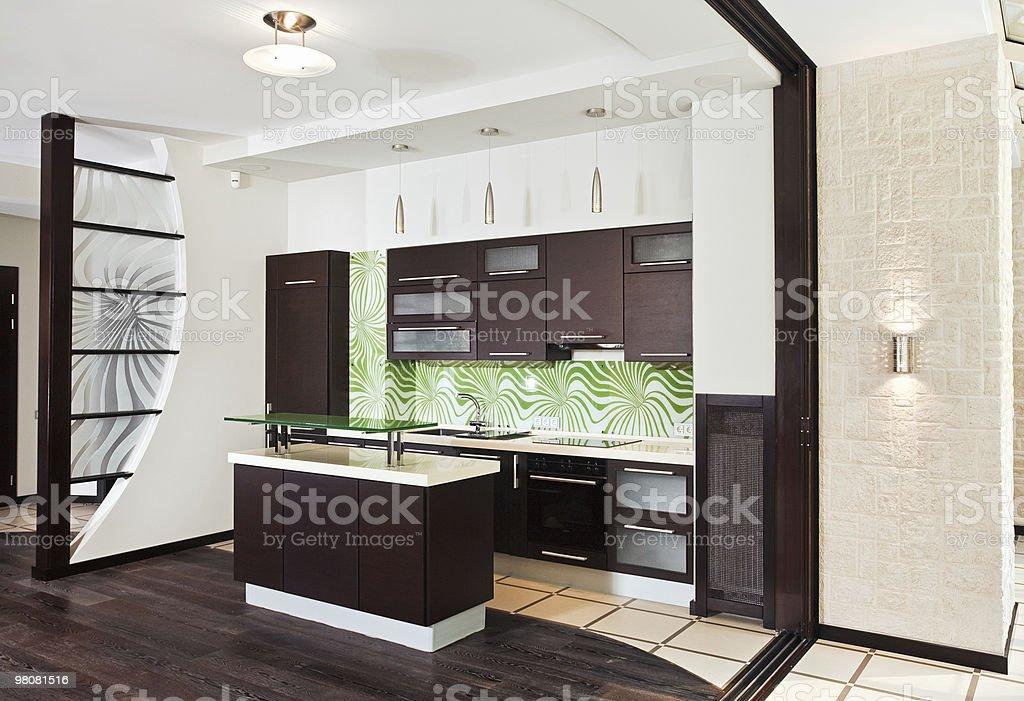 Modern kitchen interior with dark wooden floor royalty-free stock photo