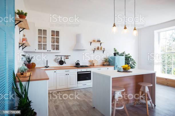 Modern kitchen interior with island sink cabinets and big window in picture id1092758366?b=1&k=6&m=1092758366&s=612x612&h=gvr8 eiubjjmfshpe8htu5d8ayi grhcnomqtabhema=
