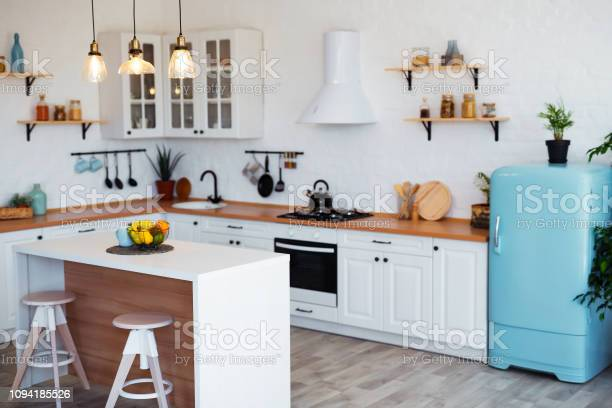 Modern kitchen interior with island sink cabinets and big window in picture id1094185526?b=1&k=6&m=1094185526&s=612x612&h=v5ixs6cmxwqqocfyhsnhrkghfzv2h5cfmmrtlvt80bw=