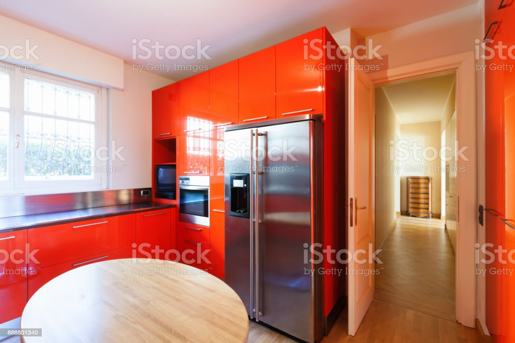 Modern kitchen lacquered with red stock photo