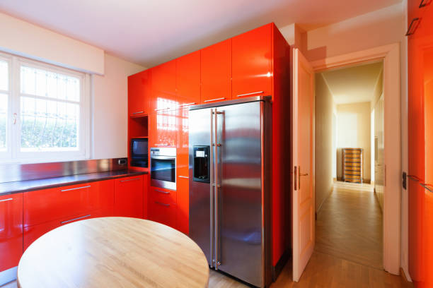 Modern kitchen lacquered with red Modern wide kitchen lacquered red, modern wood table lacquered stock pictures, royalty-free photos & images
