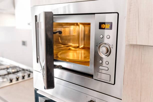Modern kitchen microwave oven stock photo