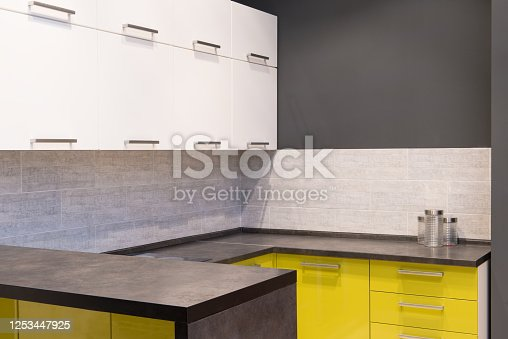 665910118 istock photo Modern kitchen room interior with furniture and counter for concept design - light home background 1253447925