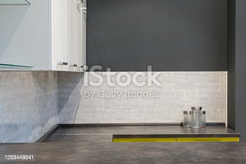 665910118 istock photo Modern kitchen room interior with furniture and counter for concept design - light home background 1253449341
