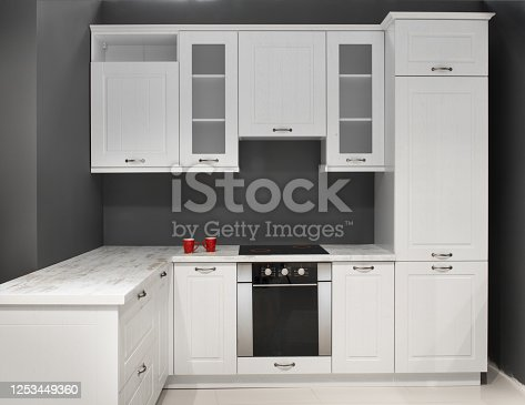 665910118 istock photo Modern kitchen room interior with furniture and counter for concept design - light home background 1253449360