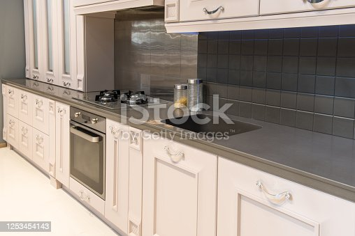 665910118 istock photo Modern kitchen room interior with furniture and counter for concept design - home background 1253454143