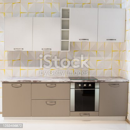665910118 istock photo Modern kitchen room interior with furniture and counter for concept design - light home background 1253456872