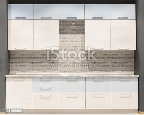665910118 istock photo Modern kitchen room interior with furniture and counter for concept design - light home background 1253456889