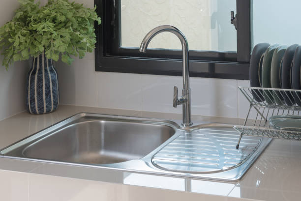 modern kitchen room with sink on counter stock photo
