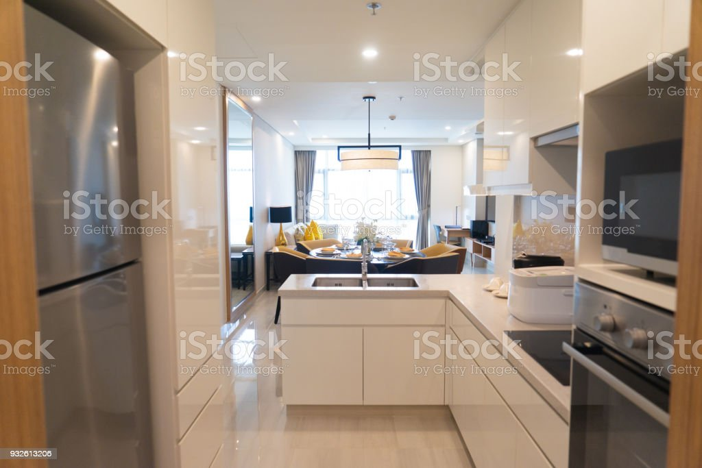 Modern kitchen set with appliances in studio flat with combined...