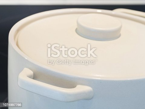 modern kitchen stove with pots close-up lids