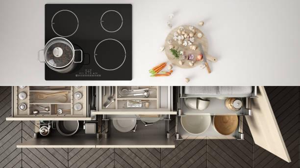 moderne küche draufsicht, öffnete schubladen und herd mit kochen pfanne, minimalistischen innenarchitektur - schrank stock-fotos und bilder