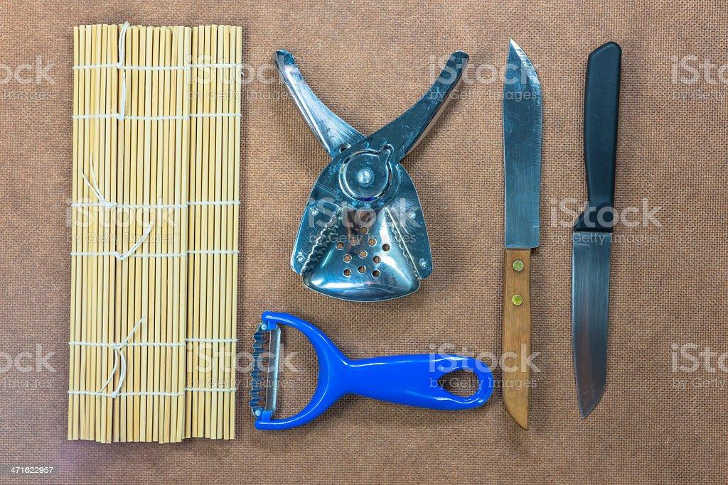Modern kitchen utensils on brown background royalty-free stock photo