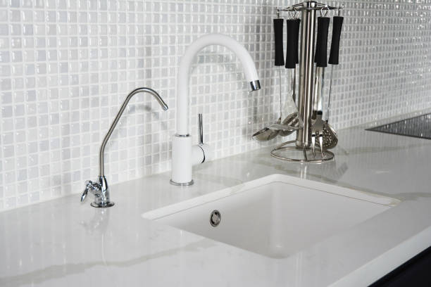 modern kitchen white faucet and sink - kitchen sink stock photos and pictures