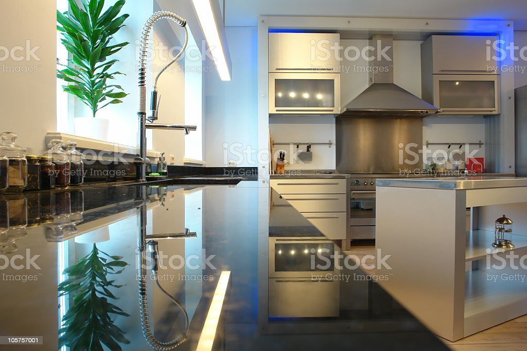 A modern kitchen with a granite countertop royalty-free stock photo