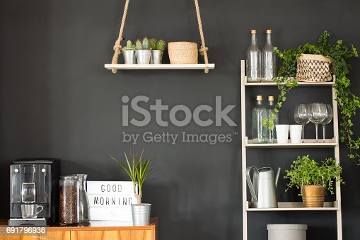istock Modern kitchen with black wall 691796936