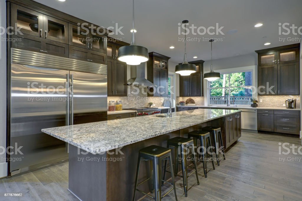 Modern Kitchen With Brown Kitchen Cabinets Stock Photo ...