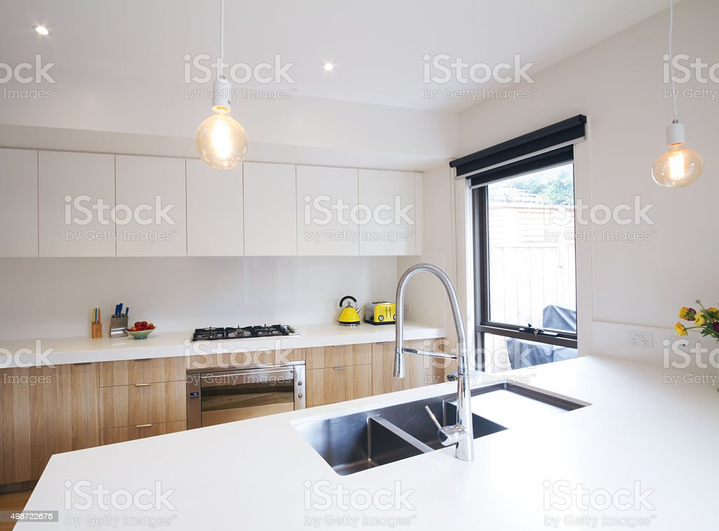 Modern kitchen with pendant lighting and sunken sink stock photo