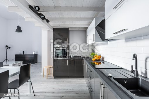 istock Modern kitchen with rustic ceiling 694247724