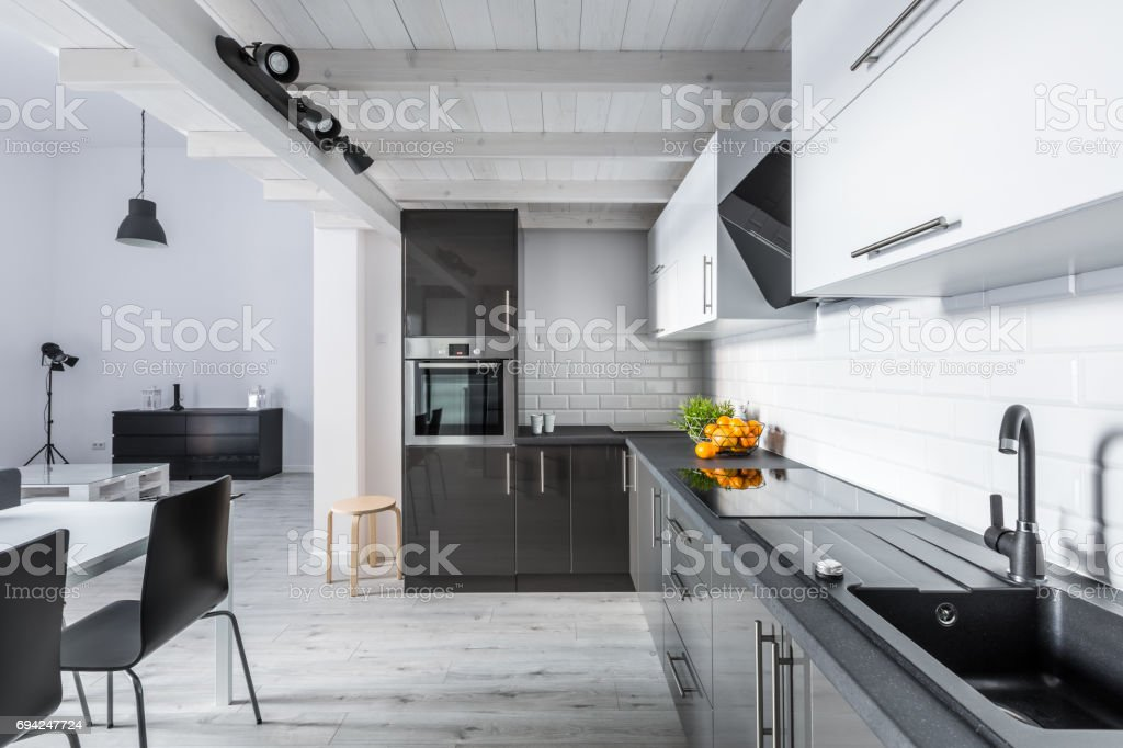 Modern kitchen with rustic ceiling stock photo