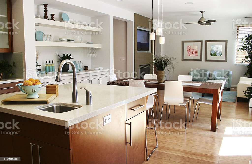 Modern kitchen with sitting and dining area stock photo