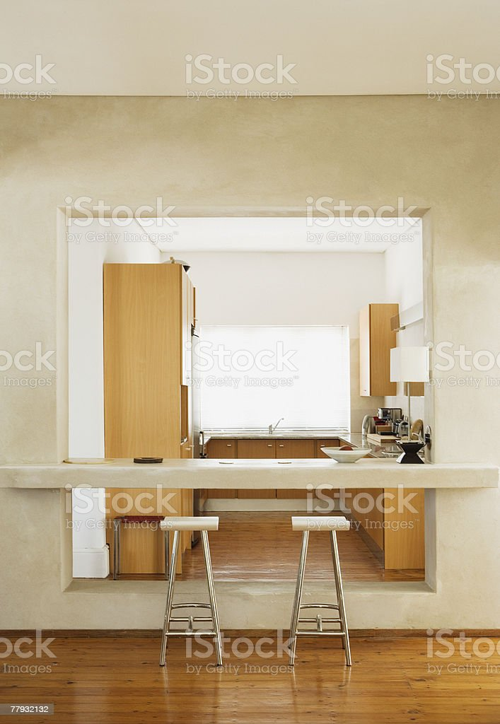 Modern kitchen with stools royalty-free stock photo