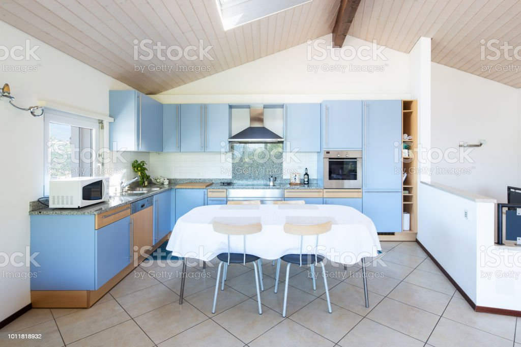 Modern kitchen with table and chairs stock photo