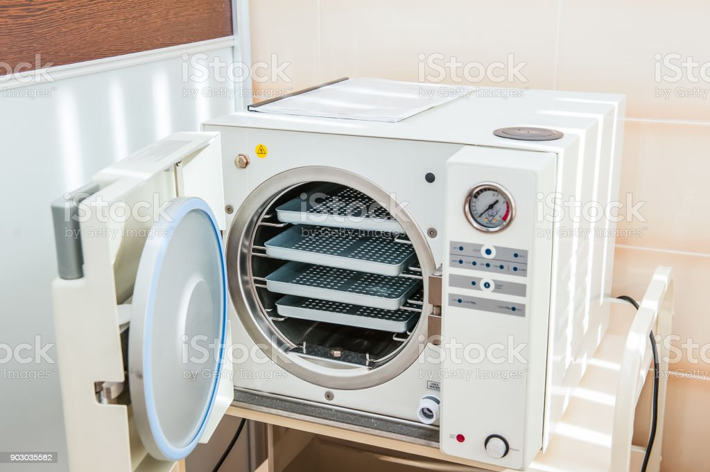 Modern laboratory autoclave sterilizer on the table stock photo
