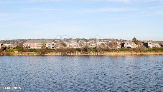 view of modern lakeside housing development