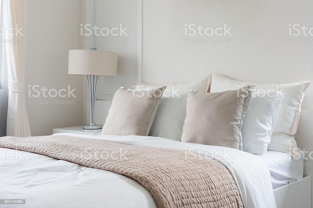 modern lamp on table side with picture frame on wall stock photo
