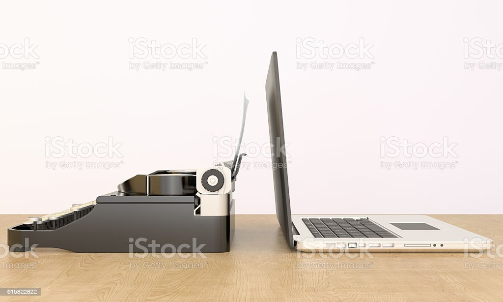 Modern Laptop and Antique Typewriter stock photo