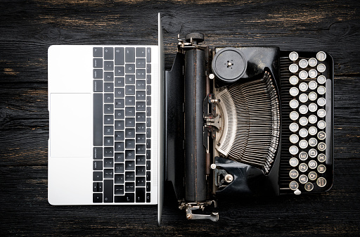 Modern Laptop Computer with Antique Typewriter