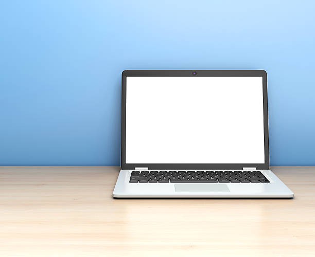 Modern laptop on table on blue background. – Foto