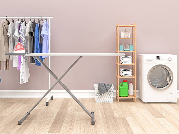 modern laundry room with washing machine and  cleaning supplies - laundry laundry room stock pictures, royalty-free photos & images