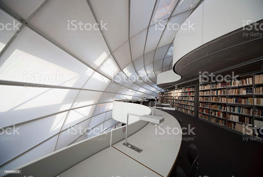 Modern library with books and white light stock photo