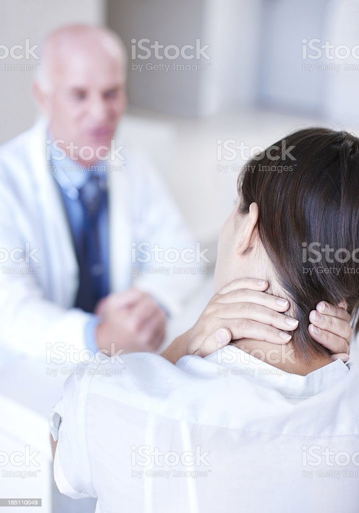 Modern life can be a pain in the neck royalty-free stock photo