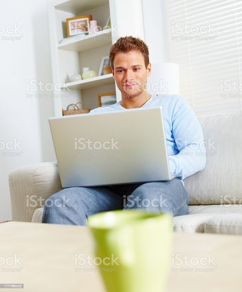 Modern lifestyle - Fresh young man using laptop stock photo