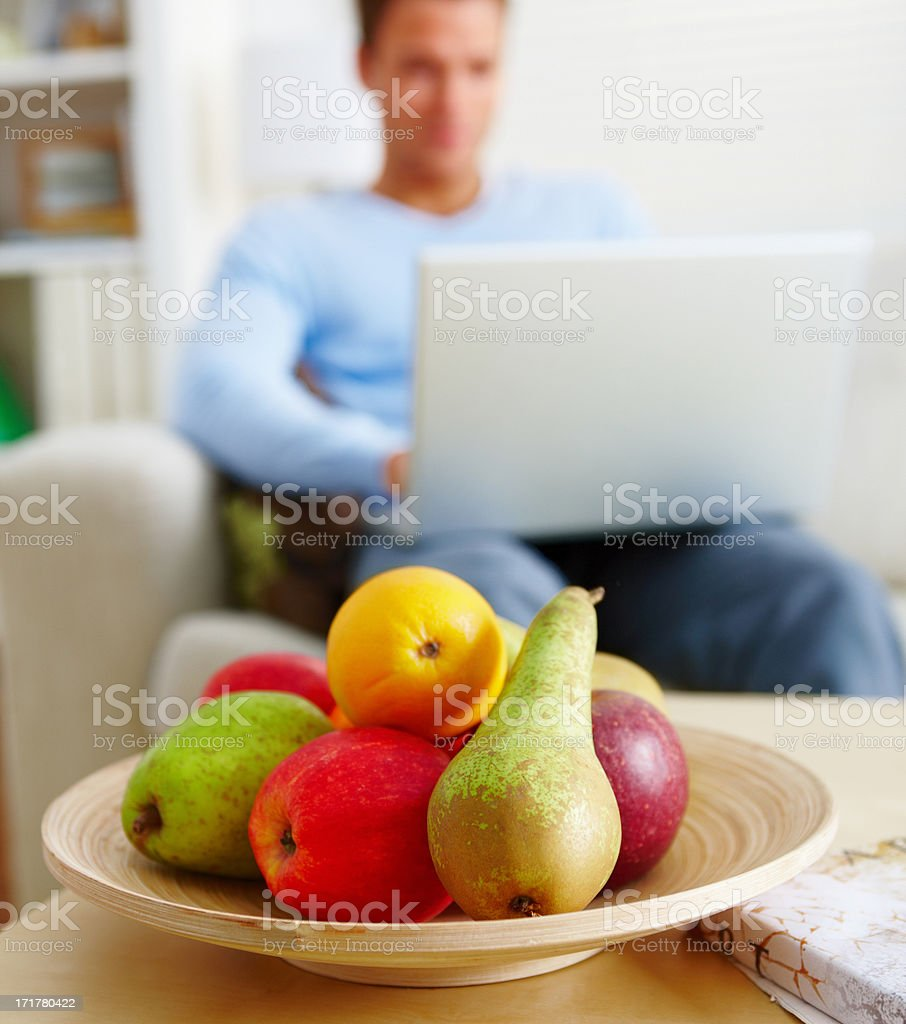 Modern lifestyle - Man using laptop at home stock photo