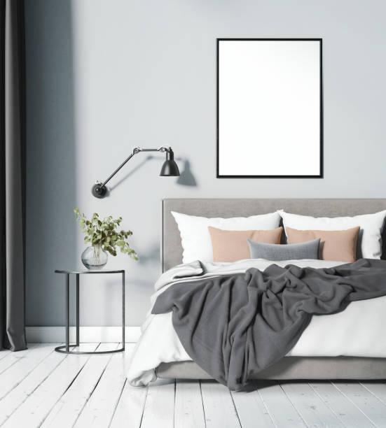 Modern light blue Scandinavian bedroom with blank frame stock photo