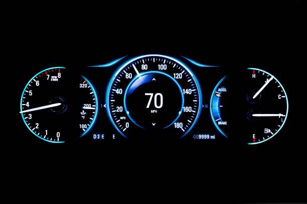 Modern light car mileage on black background 70 mph stock photo