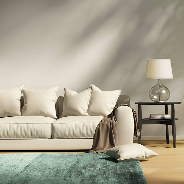 Modern light grey sofa in a contemprary living room stock photo