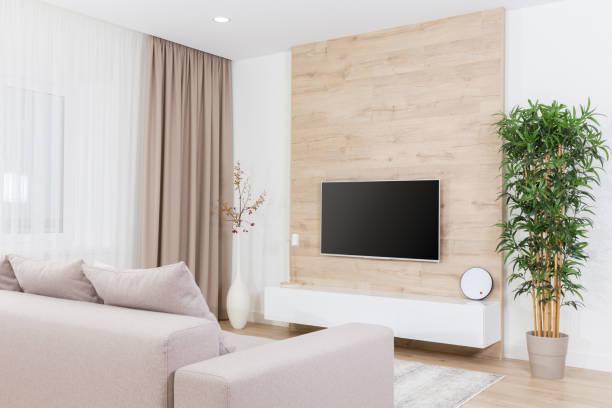 Modern light living room with tv equipment stock photo