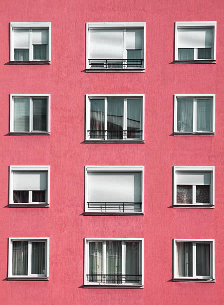 Modern light red housing block exterior stock photo