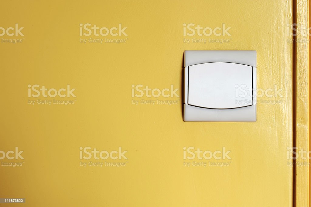 Modern Light Switch on Yellow Wall royalty-free stock photo